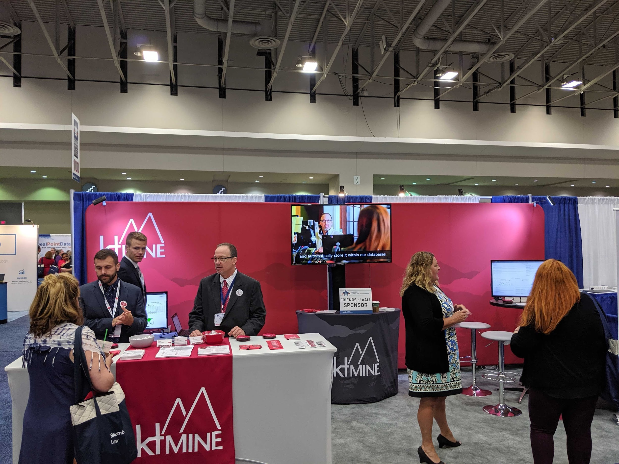 ktMINE talks to attendees in the booth at the 2019 AALL Annual Meeting