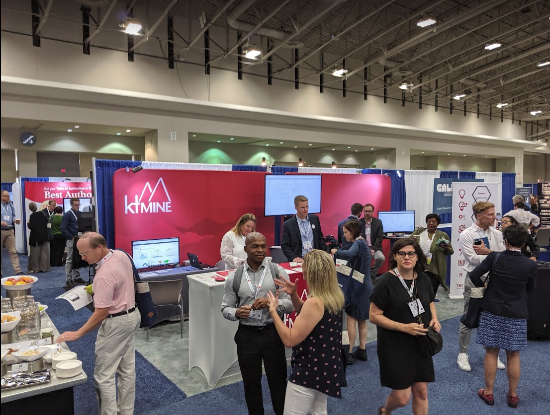 Attendees mingle around the ktMINE booth at the AALL Annual Meeting in 2019
